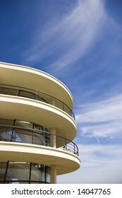 An Art-deco balcony against a blue sky