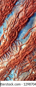 arteries of the desert, tribute to Pollock, vertical abstract photography of the deserts of Africa from the air,aerial view, abstract expressionism, contemporary photographic art, abstract naturalism,