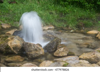Artesian well. Eruption of spring, natural environment. Stones and water. Clean drinking groundwater erupting out of the ground. Norra Spring Area, Oostriku River, Endla Nature Reserv, Estonia, Europe