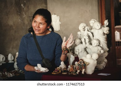 Artesian woman makes a ceramics in the alabaster stone, also known as Huamanga stone, February 2012 Ayacucho, Peru.