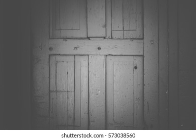 Artful black and white weathered wooden doors in Santa Fe, New Mexico