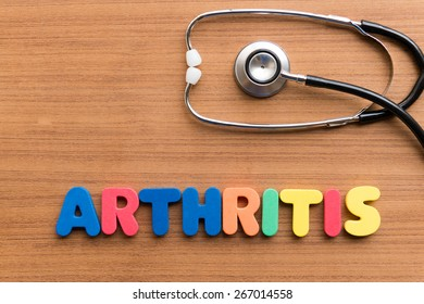arthritis colorful word on the wooden background