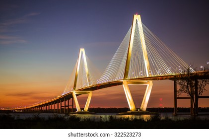 Arthur Ravenel Jr Bridge Illuminated in Evening over Cooper River Connecting Charleston and Mount Pleasant in South Carolina