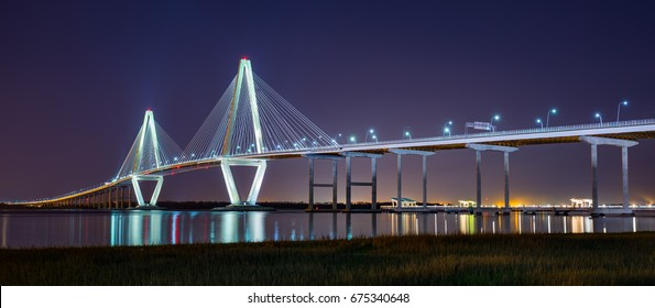 The Arthur Ravenel Jr. Bridge lit up at night in Charleston South Carolina.