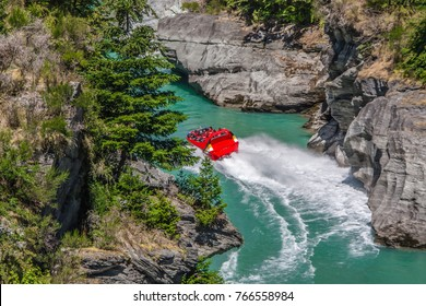 arthurs point, queenstown, jet boating at dart river in new zealand