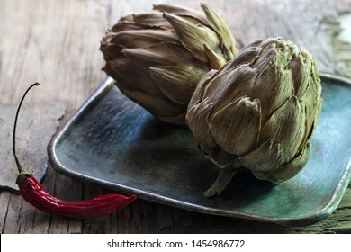 artichoke and chili on metal plate