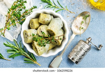 artichoke with marinad in bowl, artichoke with aroma spices