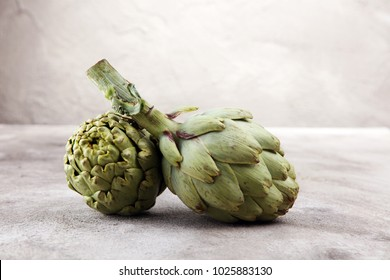 artichokes on grey background. fresh organic artichoke flower