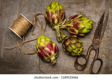 Artichokes on a metal board
