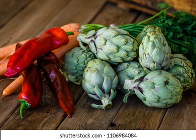 artichokes, peppers and carrots on wooden table