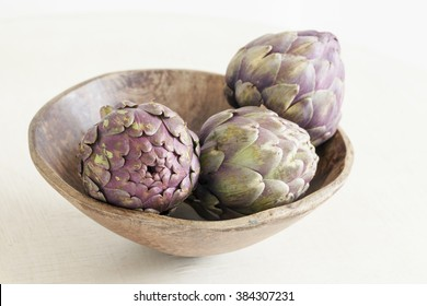 Artichokes in wooden bowl