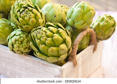 Artichokes in a wooden box. Close-up.