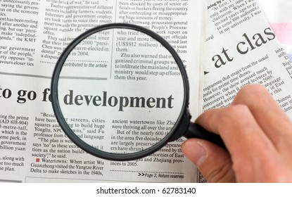 Article reading in the newspaper by means of increase a magnifier.