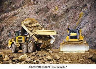 articulated dump truck, very large heavy duty type dump truck working at very large construction site