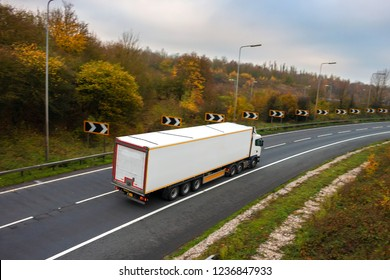 Articulated lorry in motion on the road.