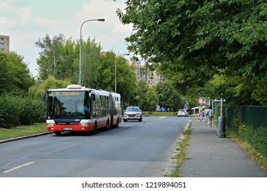"Articulated low-floor bus in Prague in summer day, ""Jižní Město"" means ""South City"""