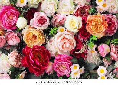 Artificial color flowers, floral carpet background