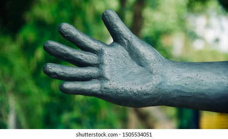 Artificial concrete black hands with fingers isolated unique photo