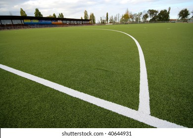 Artificial covering of a field in stadium for game in field hockey