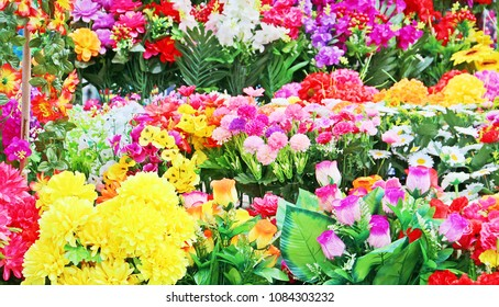Artificial flower shop in flee market. Full of colorful products