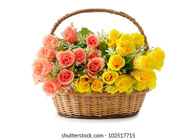 artificial flowers in basket isolate on white