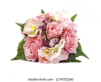 Artificial flowers. Flower bouquet in vase isolated on white backgroung.
