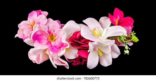 Artificial flowers isolated on black background. Clipping path included.