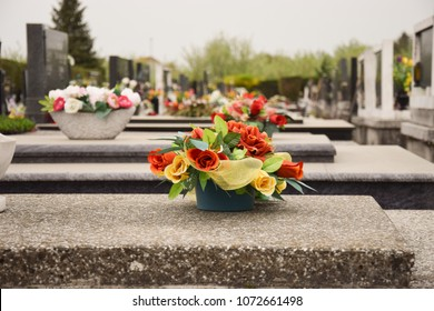 Artificial flowers on tombstones at a cemetery