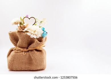 Artificial flowers in Sack on background