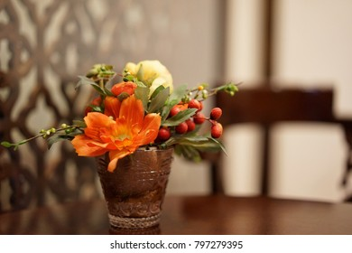 Artificial Flowers in vase on the table