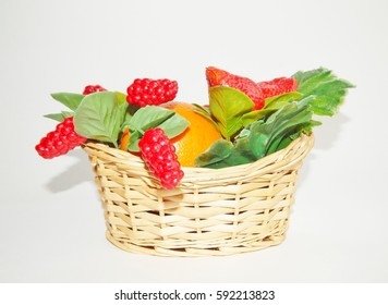 artificial fruits in a basket