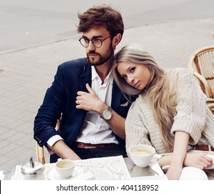 Artificial grain added style photo. Young stylish fashion couple in love sinning on the street in cloudy weather having fun outdoor
