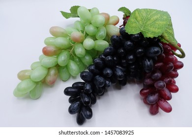 Artificial grapes on  white background
