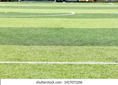 Artificial grass on the football field background