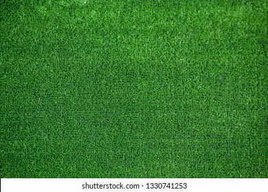 Artificial grass texture patter abstract background from top view.