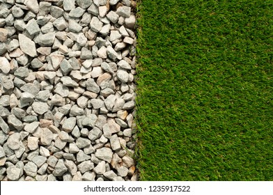 Artificial grass or turf on floor with gravel. Top view. Green Plastic grass