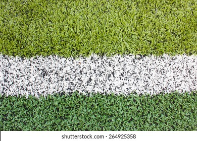 Artificial grass with white stripe