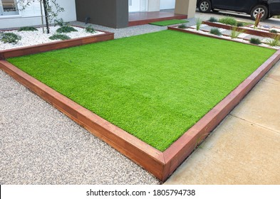 Artificial grass/lawn turf in the front yard of a modern home/residential house.