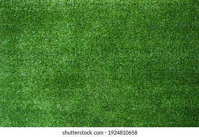 Artificial green grass texture background top view.