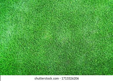 Artificial green grass textured background