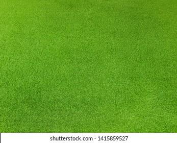 Artificial green grass top view background texture concept.