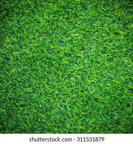 Artificial green grass , artificial turf background and texture.