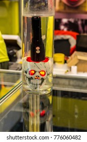 An artificial human skull with red eyes. Tactical flashlight. An artificial human skull with red eyes. Tactical flashlight. Waterproof flashlight.