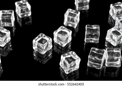 Artificial ice cube over black background
