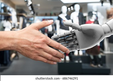 Artificial intelligence (AI) advisor or robo-adviser in smart retail technology. Shaking hands of male executive director and 3d rendering robot. Blur fashion retail mall background.
