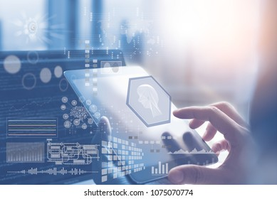 Artificial Intelligence AI, Big data, Internet of Things IoT. Business man using digital tablet with coding on laptop computer, technology background, deep learning, industrial technology development