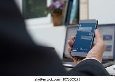 Artificial intelligence, Ai concept, business man using mobile smart phone with chatbot application on screen, working on laptop computer in office, chat bot, internet network communication