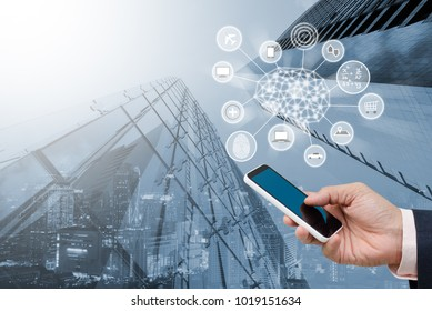 Artificial Intelligence AI, Internet of Things IoT. Business man using mobile smart phone on city background, omnichannel marketting, smart phone chatbot application, 4.0 industrial technology