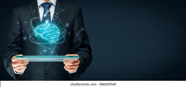 Artificial intelligence (AI), machine deep learning, data mining and modern computer technologies concepts. Brain representing artificial intelligence and businessman holding futuristic tablet.