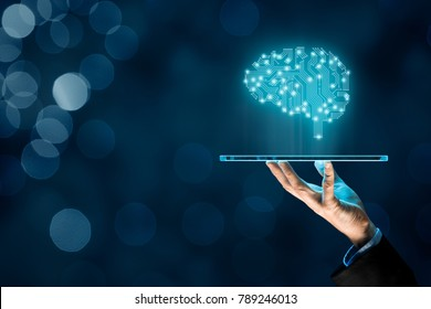 Artificial intelligence (AI), machine deep learning and another modern computer technologies concepts. Brain representing artificial intelligence and businessman holding futuristic tablet.